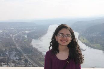 Posing in front of the majestic Rhine River in the Drachenfels from a top view.