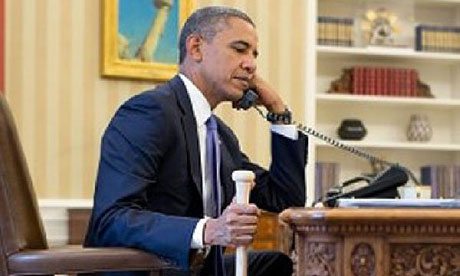 Obama holds baseball bat whilst on the phone to the TUrkish president.
