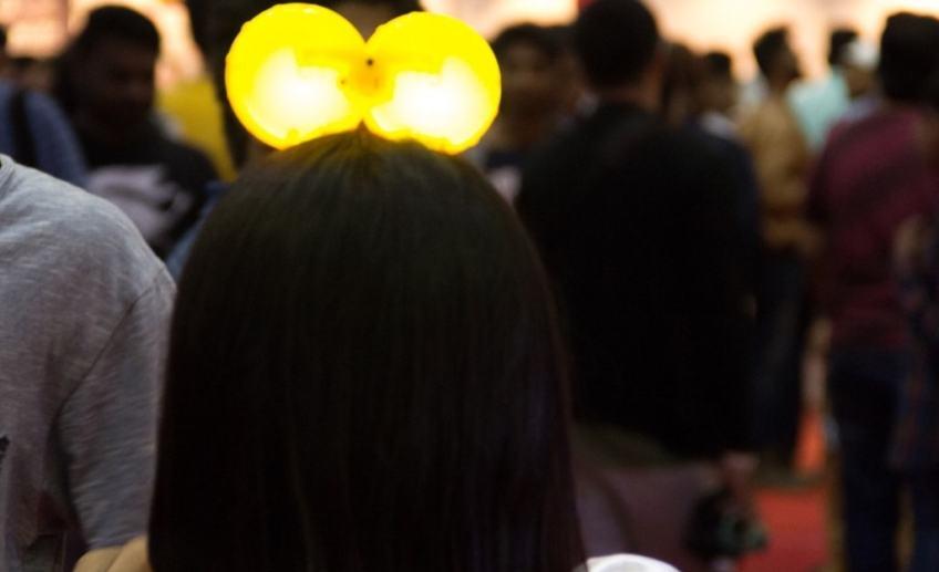 girl wearing a funky neon head band