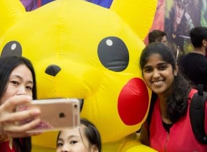 Deepthi posing with Pikachu mascot