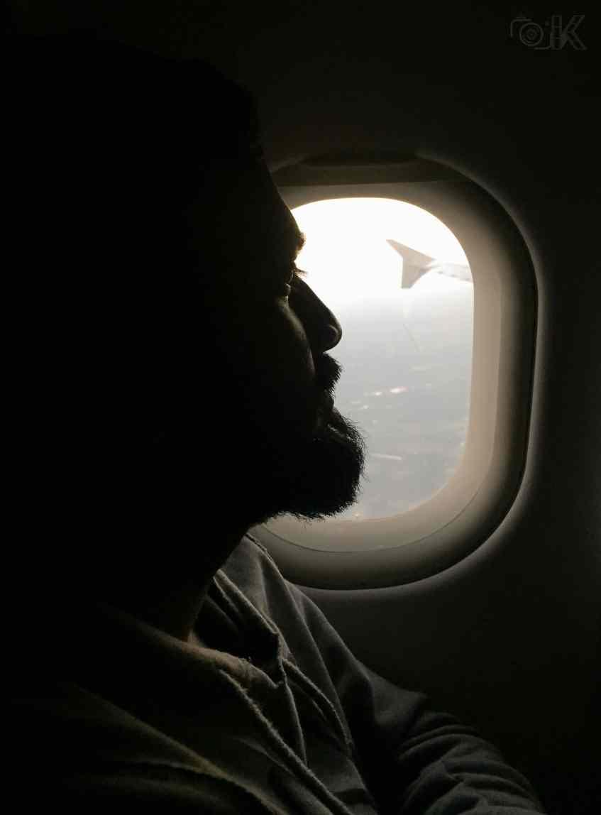 ashok enjoying the view from the airplane window