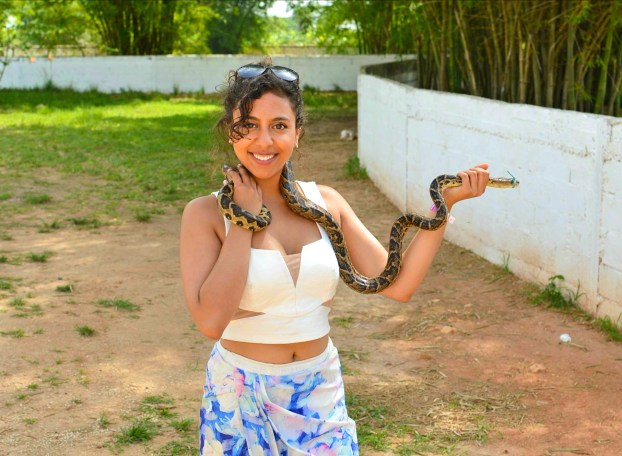 posing with a snake