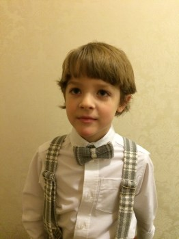 Cullen in his bow tie and suspenders, he had a matching pillow my mom made to carry the rings down the aisle.