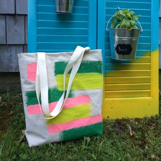 I painted a piece of canvas then made it into a bag, the liner is bright pink with a green zipped top. I'm still using this tote but the straps are not holding up.