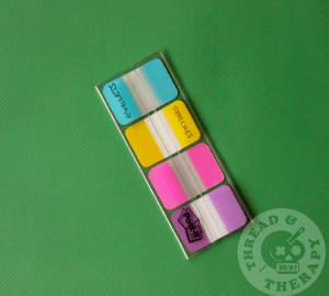 The author's set of sticky tabs against a green backdrop.
