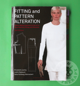 The author's copy of Fitting and Pattern alteration against a green backdrop.