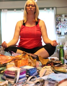 Bridget O'Flaherty in a yoga pose with bundles of fabric