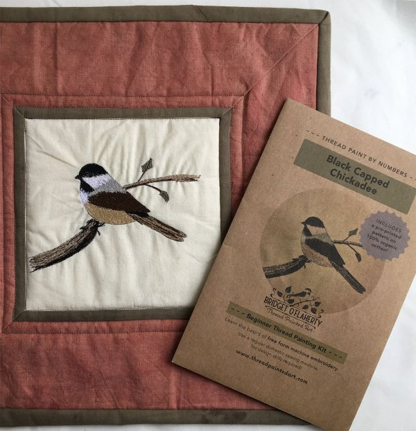 chickadee thread painting finished as a small quilt