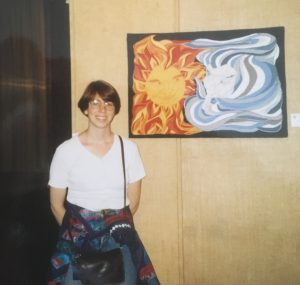Bridget O'Flaherty Standing beside North Wind and the Sun quilt at NJS Halifax 1994