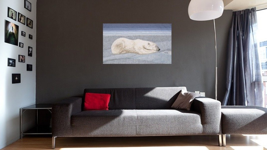 Tranquility Thread painting of polar bear in living room setting with dark walls