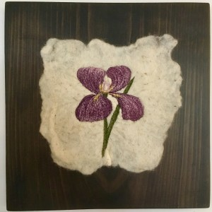 Purple Iris threadpainted on felted fabric mounted in wood