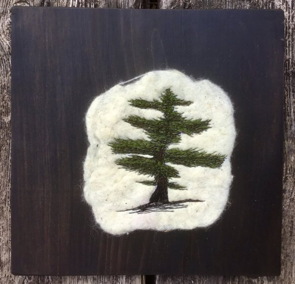 White pine tree free motion embroidered on felted fabric and pine board