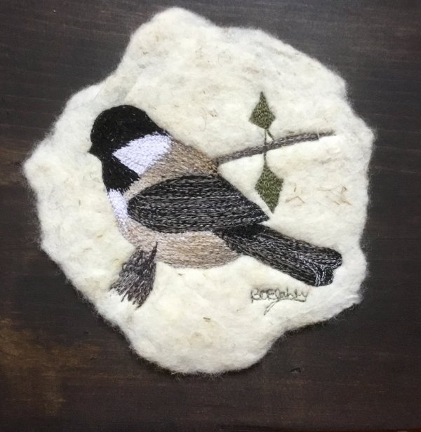 free motion embroidery of a chickadee on felt