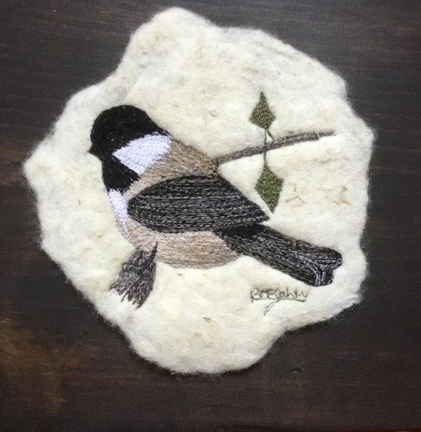 free motion embroidery of a chickadee on felt