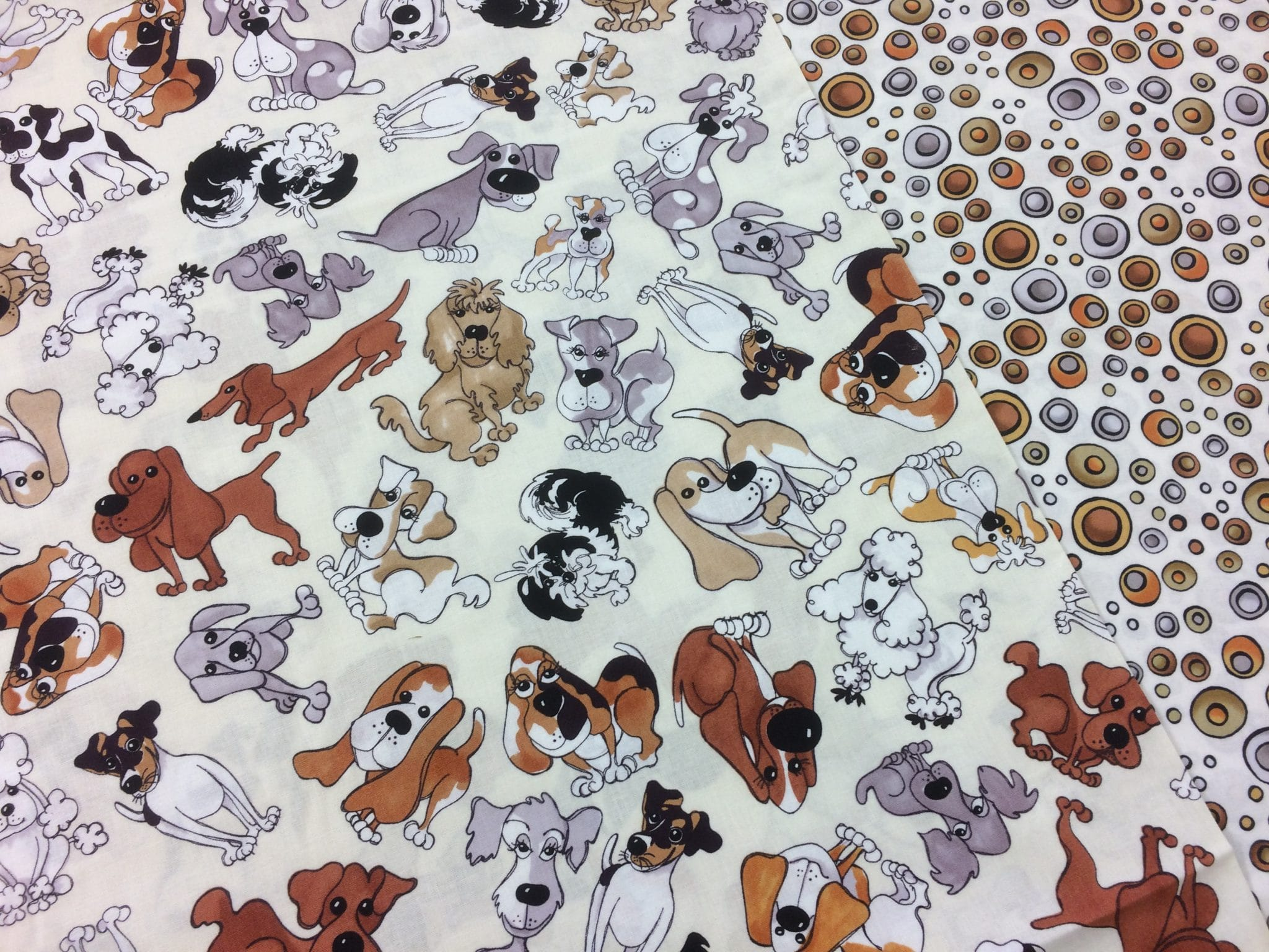 Nutex 'Tossed Doggies' and its coordinating 'Doggie Dots' by Loralie Designs –