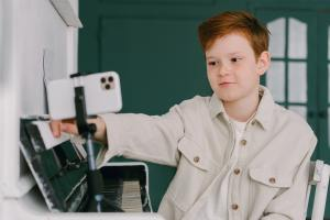 Elementary school boy looking at a computer screen