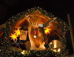 The moose croons Christmas tunes.