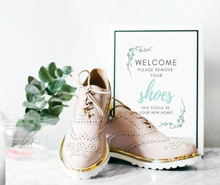 open house welcome sign shoes