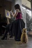 cat watching woman paint