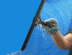 Window cleaning with a squeegee