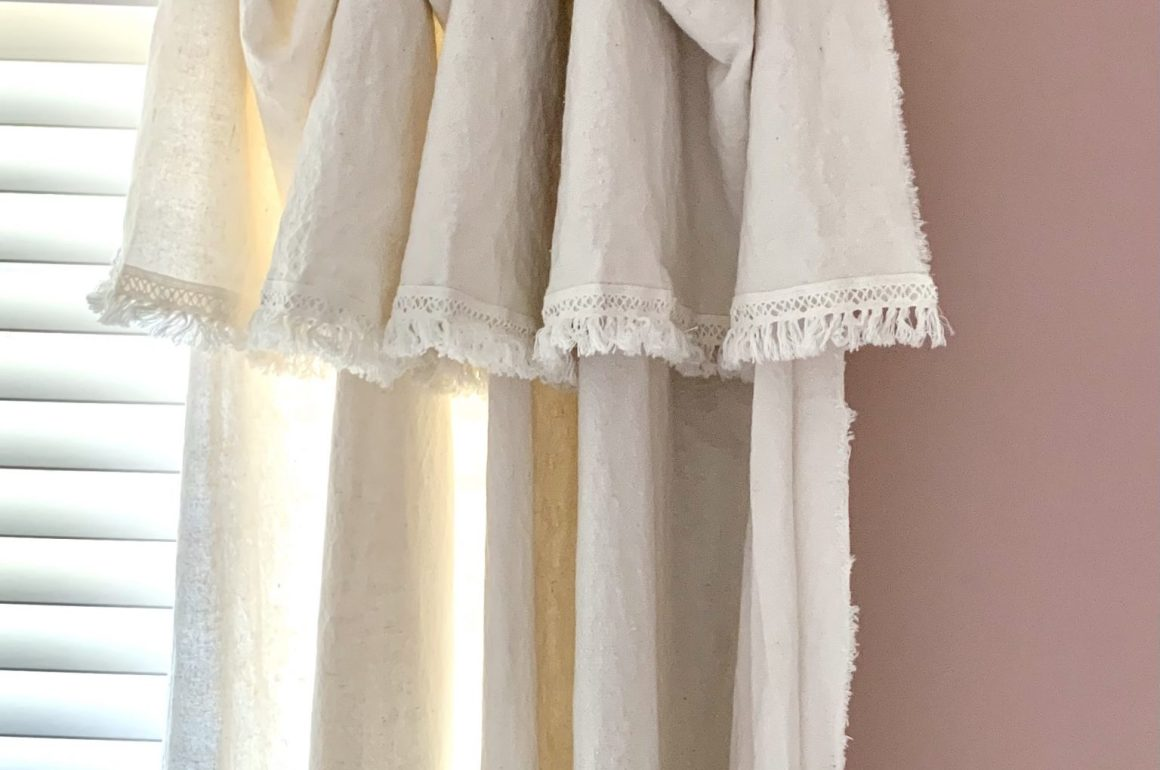 drop cloth curtains with a lace fringe edge accent