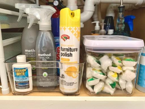 under the kitchen sink organization with clear storage bins