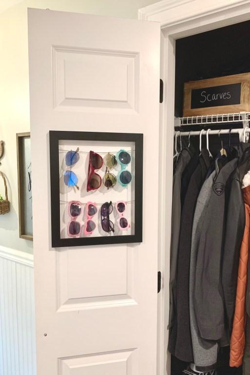 black framed sunglasses rack in coat closet