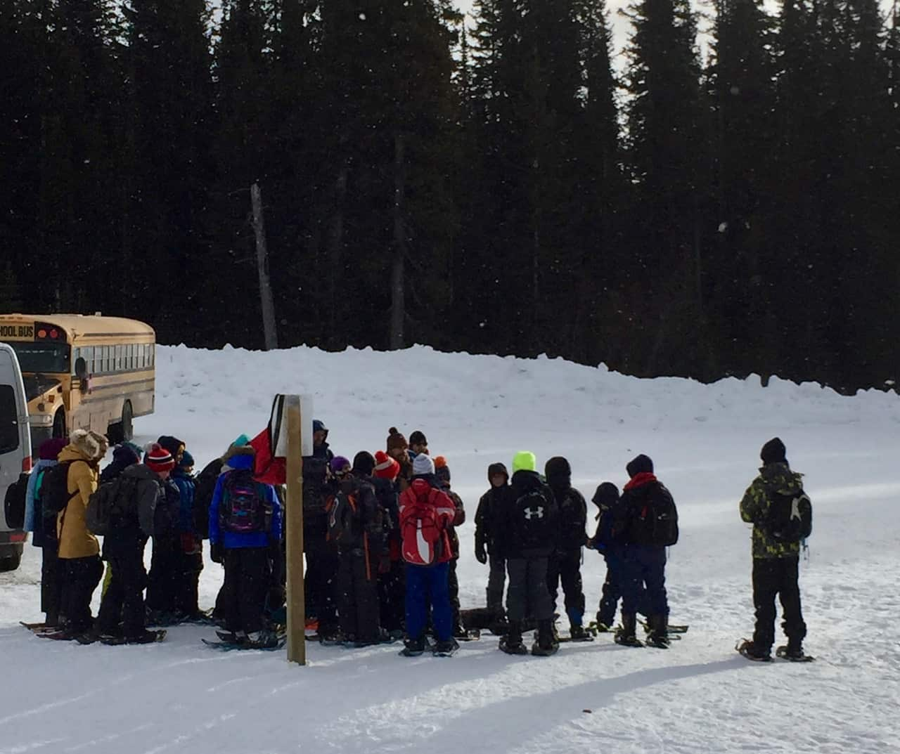 group of students snowshoeing