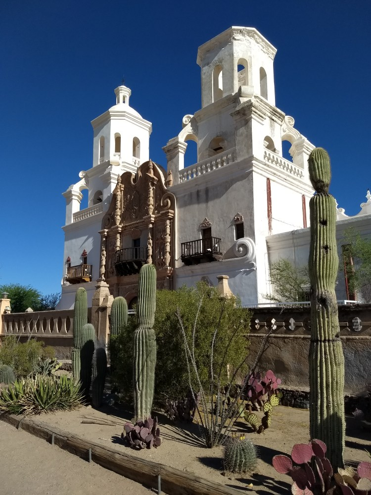 San Xavier Mission, view of the architecture and cactus and desert landscaping influential in decision whether to retire in Tucson.