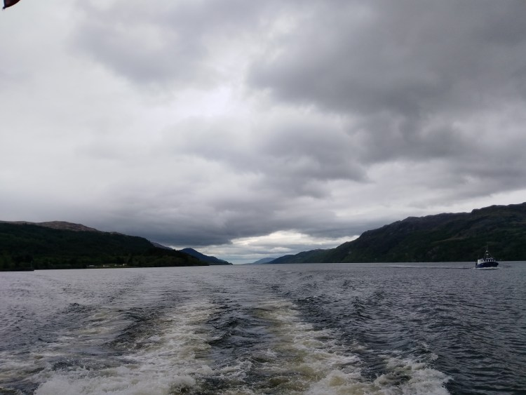View of Loch Ness from the tour boat on a cloudy day