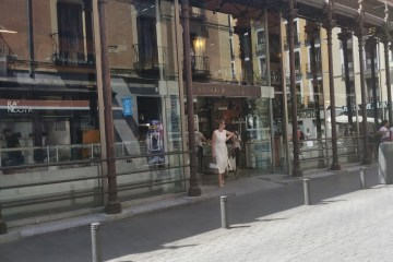 Mercado San Miguel Madrid Market with a women in white leaving