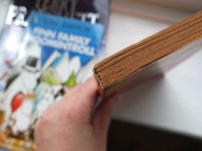 Old paperback showing stitched sections
