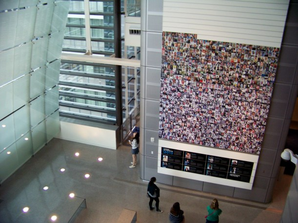 Wall of photos of deceased journalist. Photo by Mike Hartley