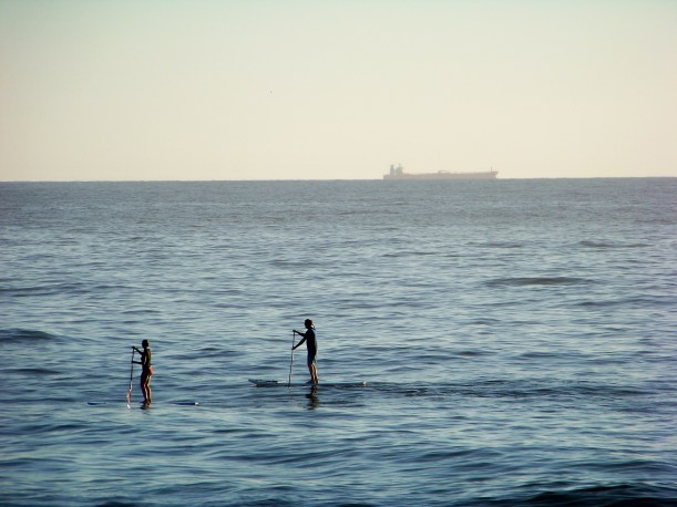 paddle boarding on the Atlantic ocean. sharing the high seas with a freighter. Photo by Mike Hartley