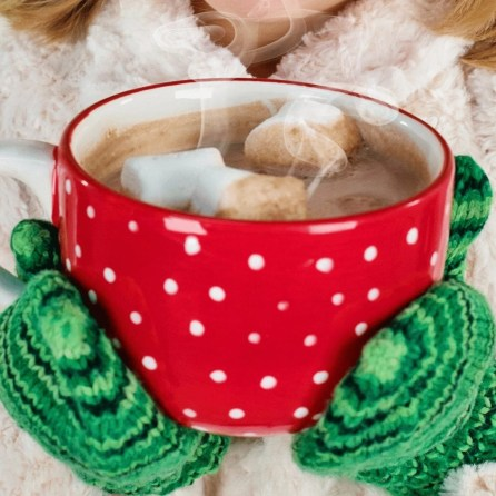 red cup with white dots filled with hot cocoa