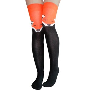 Legs in thigh high stockings with a fox design