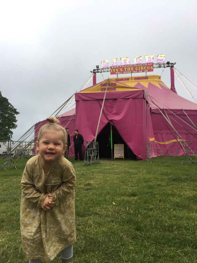 Child outside of circus