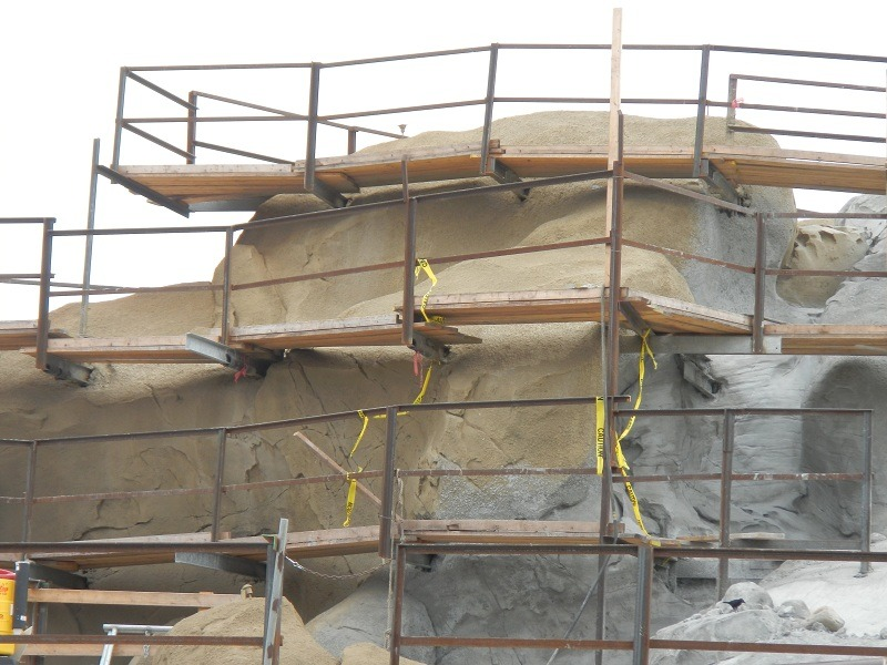 Painting has begun on the rock formations