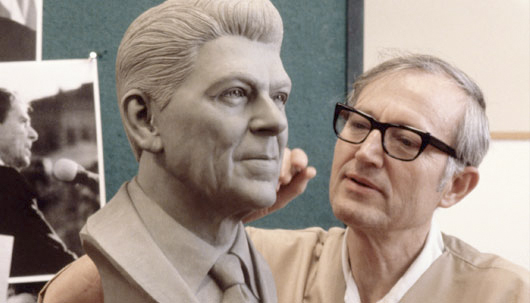 """Disney Imagineer and Legend Blaine Gibson works on his sculpture of President Ronald Reagan for the Walt Disney World attraction """"Hall of Presidents."""" Photo Courtesy: The Disneyland Resort."""
