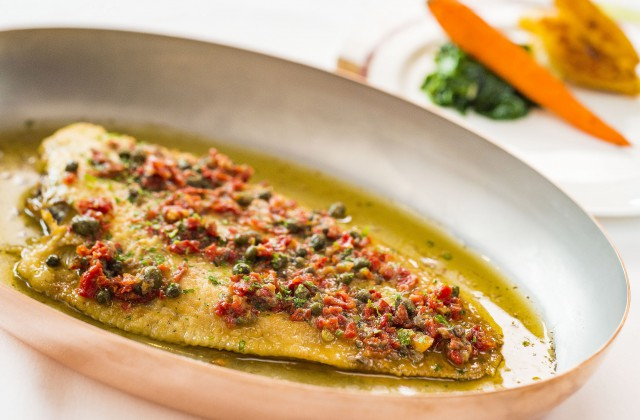 Dover sole, fileted tableside and served with regional staples like capers, anchovies, sundried tomatoes and thyme potatoes. (Matt Stroshane, photographer)
