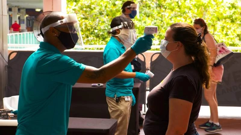 As theme parks revise pandemic guidelines, Florida reports 4,623 new COVID-19 cases