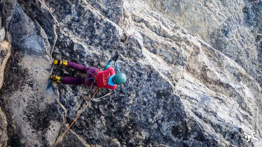 Negotiating the looong roof crux of Red Bull & Vodka (P1).  Blew it just after the crux with only the anchors left to clip.  Classic!<br><br>Photo: Janette Heung