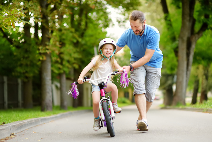 girl learning to ride bike