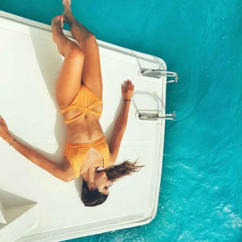 slim woman sunbathing