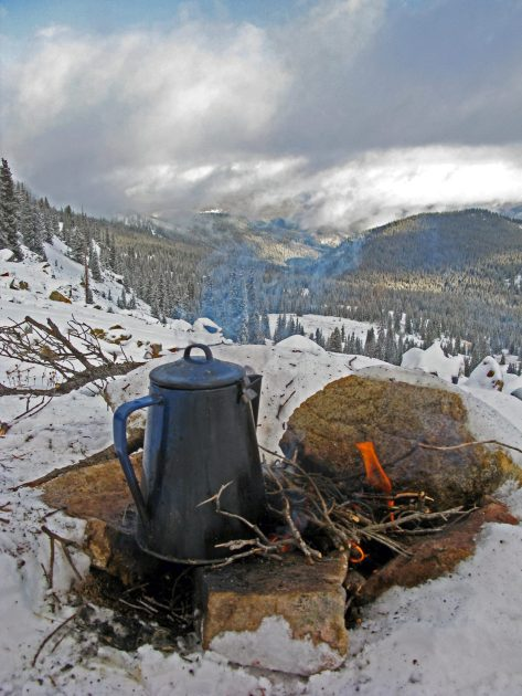 A Steaming Pot of Coffee on an Outdoor campfire on a Ridge Overlooking Elk Country During a Colorado Elk Hunt