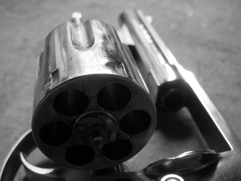 A colse-up photo of a .357 magnum revolver, a handgun or pistol for home protection and self defense