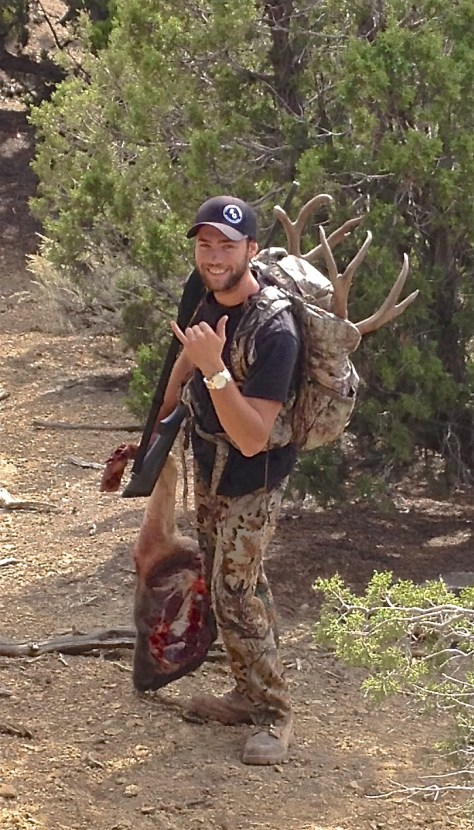 MacKenzie Hayes of Glenwood Springs packs out his trophy mule deer taken in northwestern colorado in 2015.