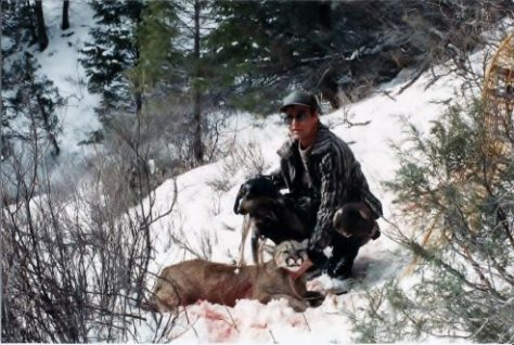 Michael Patrick McCarty poses with a mountain lion taken on a hunt with hounds in the winter snow of the Piceance Basin in Western Colorado