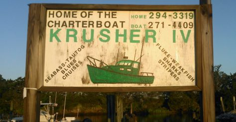 A Reminder of The Past - A Vintage Charter Boat Fishing Sign Stands Vigil Over Tuckerton Crick in New Jersey