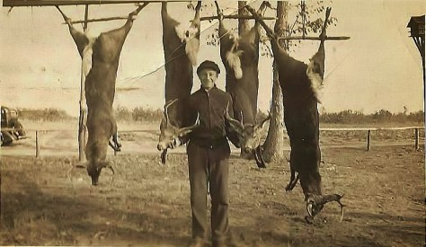 A vintage hunting photograph of Mark A. McCarty Sr. with a harvest of white-tailed deer, taken during shotgun season in southern New Jersey in the 1930's